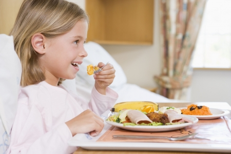 childrens meal: Young Girl Eating Hospital Food Stock Photo