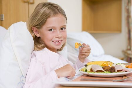 recovering: Young Girl Eating Hospital Food Stock Photo