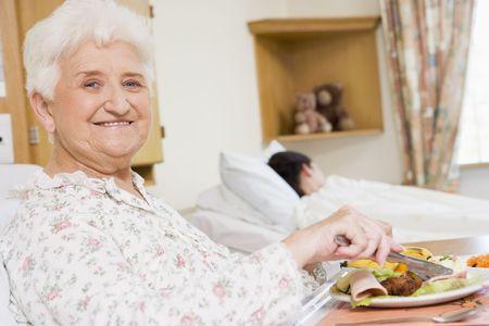 Young Woman Eating Hospital Food photo