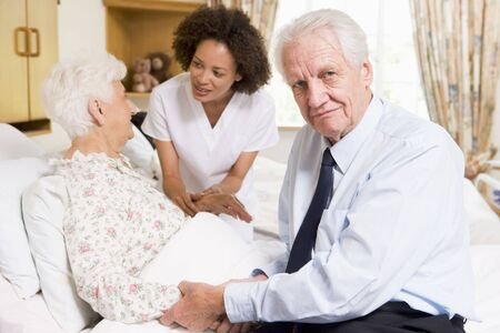 Nurse Talking To Senior Couple photo