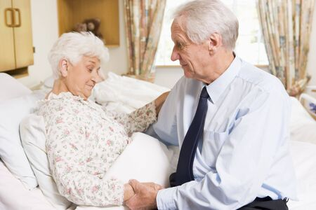 healthcare visitor: Senior Man Visiting His Wife In Hospital Stock Photo