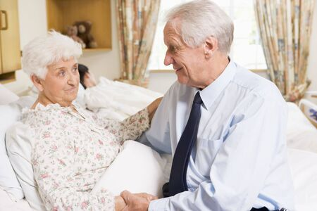 Senior Man Sitting With His Wife In Hospital photo