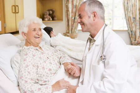 Doctor Laughing With Senior Woman In Hospital Stock Photo - 3723848