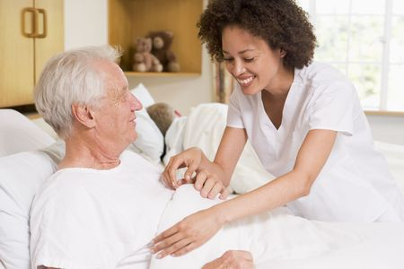 patient care: Nurse Helping Senior Man