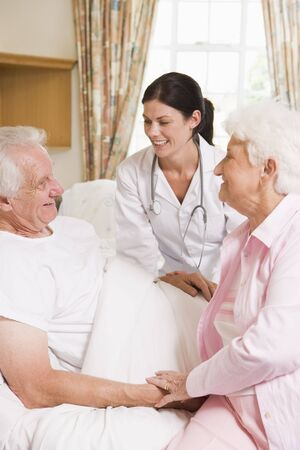 healthcare visitor: Doctor Talking To Senior Man And His Wife