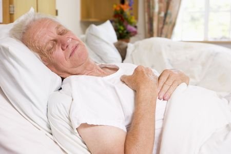 man lying down: Senior Man Asleep In Hospital Bed