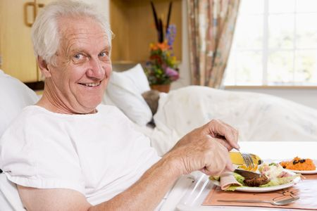 Senior Man Eating Hospital Food In Bad Stock Photo - 3723997