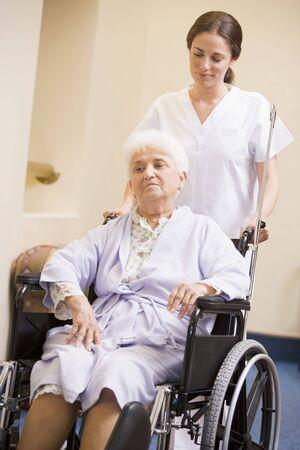 Nurse Pushing Senior Woman In Wheelchair Stock Photo - 3724103