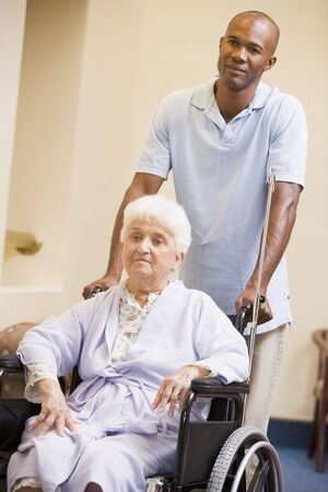 Nurse Pushing Senior Woman In Wheelchair Stock Photo - 3724111