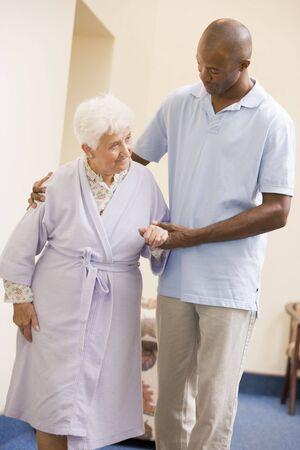 Nurse Helping Senior Woman To Walk Stock Photo - 3724387