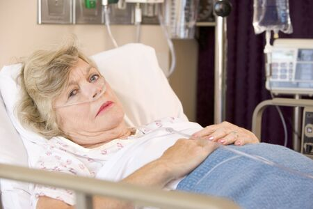 Senior Woman Sleeping In Hospital Bed Stock Photo - 3724260