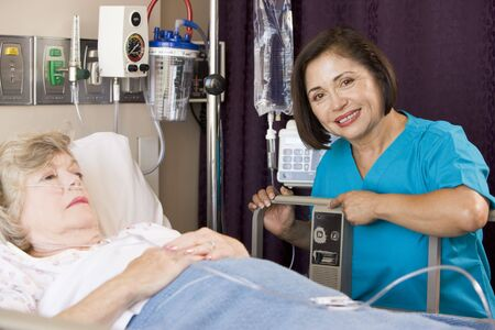 Doctor Checking Up On Senior Woman Patient photo