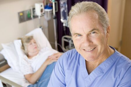 Doctor Standing And Smiling In Patients Room photo