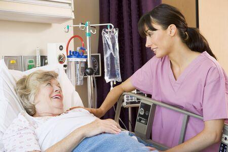 Nurse Talking To Senior Woman photo