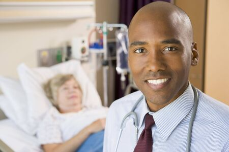 Doctor Smiling,Standing In Hospital Room Stock Photo - 3724299