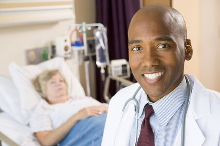 Doctor Smiling In Patients Room photo