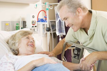 healthcare visitor: Mother And Son Laughing Together In Hospital Stock Photo