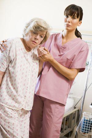 Nurse Helping Senior Woman To Walk Stock Photo - 3724292