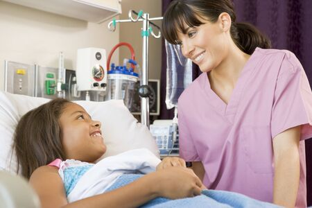 Nurse Talking To Young Patient photo