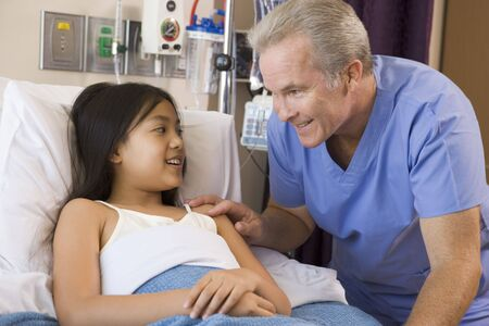 Doctor Checking Up On Patient photo