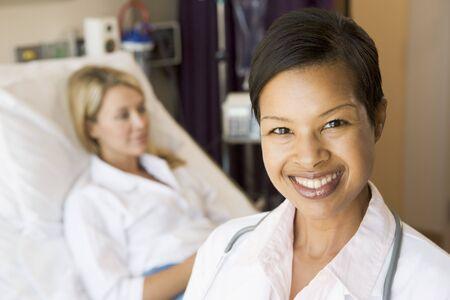 Nurse Standing In Patients Room photo