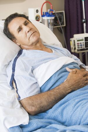 hospital patient: Man Lying In Hospital Bed Stock Photo