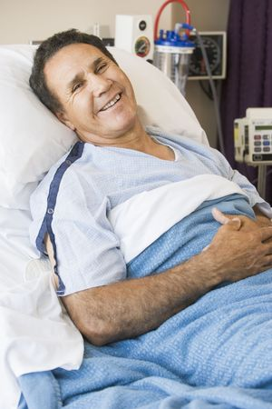 happy patient: Middle Aged Man Lying In Hospital Bed
