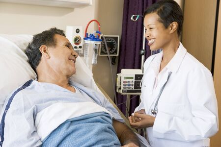 recovering: Doctor And Patient Talking To Each Other,Smiling Stock Photo