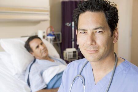 Doctor Standing In Patients Room photo