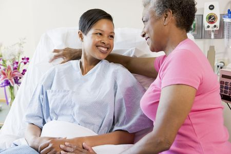 healthcare visitor: Woman And Her Mother Talking In Hospital