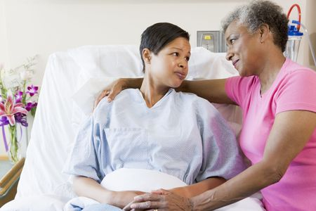 each: Mother And Daughter Looking At Each Other In Hospital Stock Photo
