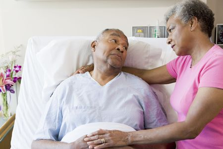 Senior Couple Looking Serious In Hospital photo