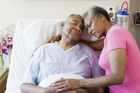 healthcare visitor: Senior Couple Embracing In Hospital