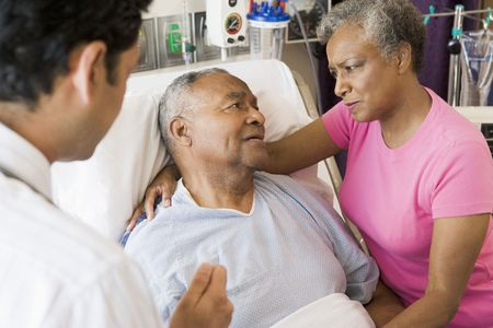 Senior Couple Talking To Doctor,Looking Worried photo