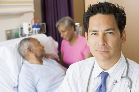 healthcare visitor: Doctor Standing In Hospital Room