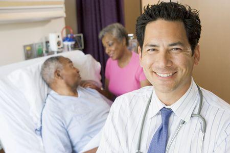 Doctor Looking Cheerful In Hospital Room photo