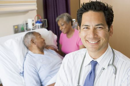 healthcare visitor: Doctor Looking Cheerful In Hospital Room Stock Photo