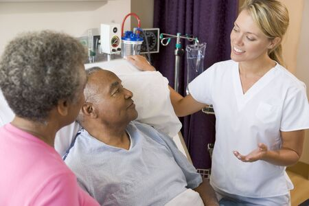 Doctor Explaining To Senior Couple Stock Photo - 3724673