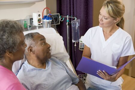 healthcare visitor: Doctor Talking To Senior Couples,Making Notes