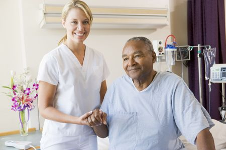 Nurse Helping Senior Man To Walk Stock Photo - 3724684