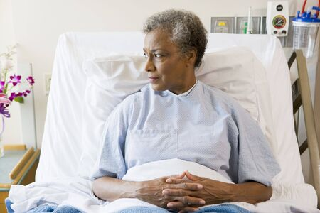 reflecting: Senior Woman Sitting In Hospital Bed