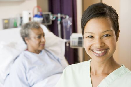helping people: Nurse Standing In Patients Room