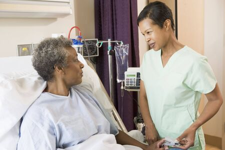 Nurse Talking To Senior Woman Stock Photo - 3724337