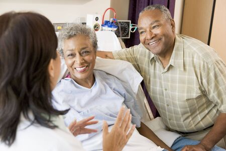 Nurse Talking To Senior Couple photo