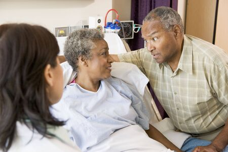 Doctor Explaining,Senior Couple Looking At Each Other photo