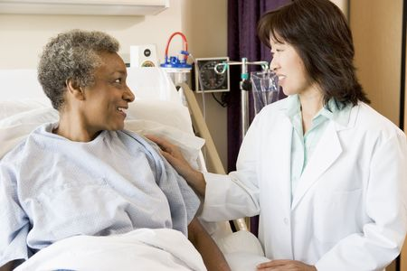 chinese american: Doctor Talking To Senior Woman