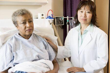 Doctor Talking To Senior Woman photo