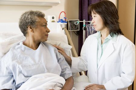 comforting: Doctor And Patient Looking At Each Other Stock Photo