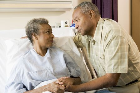 healthcare visitor: Senior Couple Standing In Hospital Together