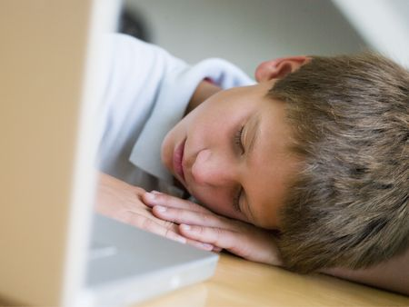 preteen boy: Young Boy Asleep By His Laptop